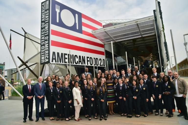 US First Lady Michelle Obama poses with workers at the United States pavilion at the Expo in Milan in 2015