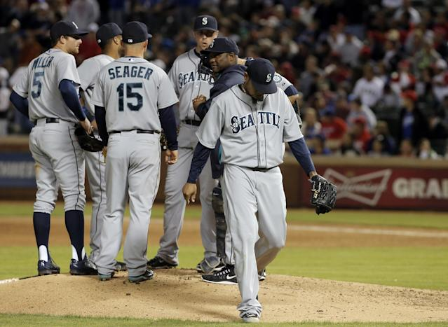 Seattle Mariners starting pitcher Felix Hernandez (34) walks to the dugout after being relieved during the eighth inning of a baseball game against the Texas Rangers, Wednesday, April 16, 2014, in Arlington, Texas. Texas won 3-2. (AP Photo/Brandon Wade)