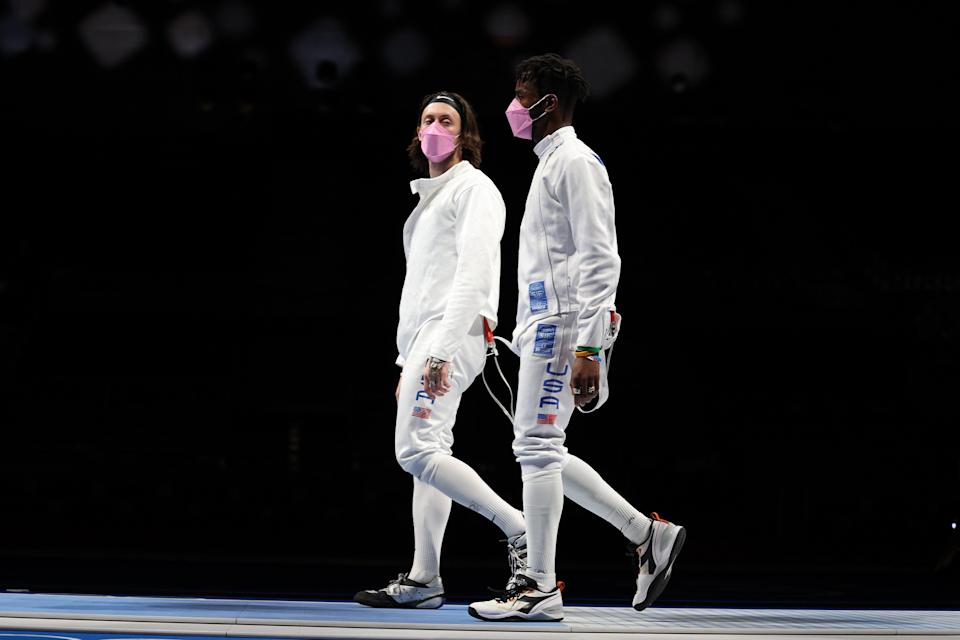 Jacob Hoyle of Team United States, left, and Curtis McDowald of Team United States react to their loss to Team Japan in Men's Épée Team Table of 16 on day seven of the Tokyo 2020 Olympic Games at Makuhari Messe Hall on July 30, 2021 in Chiba, Japan. (Getty Images)