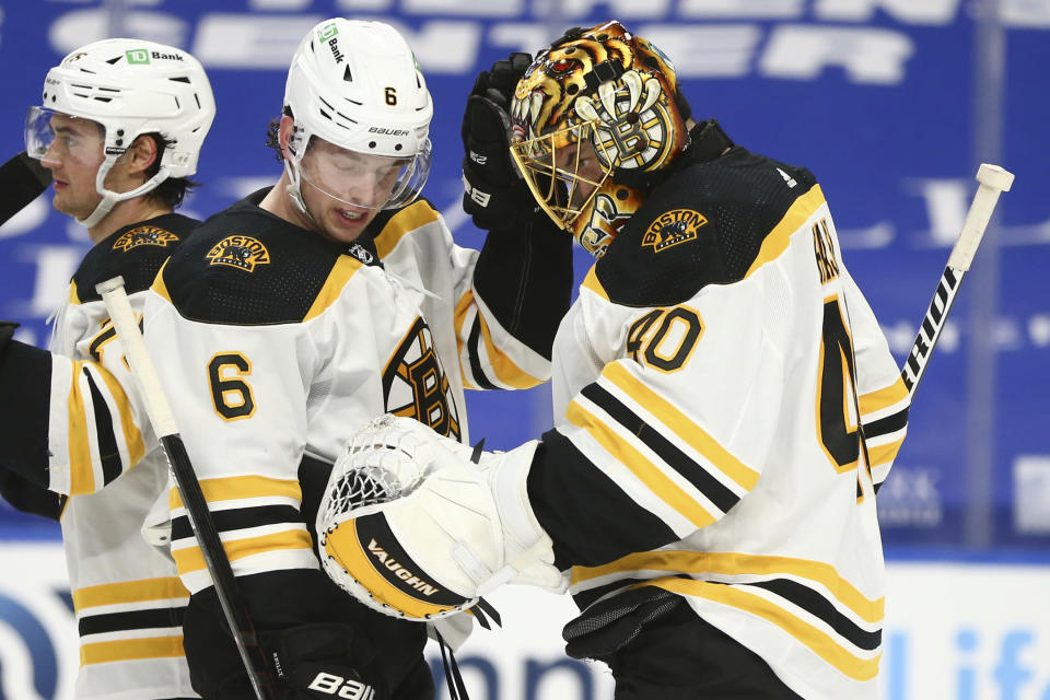 FILE - In this April 20, 2021 file photo, Boston Bruins goalie Tuukka Rask (40) and defenseman Mike Reilly (6) celebrate a victory over the Buffalo Sabres following the third period of an NHL hockey game, in Buffalo, N.Y. Trade deadline acquisitions are proving to be difference makers in the NHL playoffs. That's why teams make moves at the deadline, and it's working out for a handful so far. (AP Photo/Jeffrey T. Barnes)