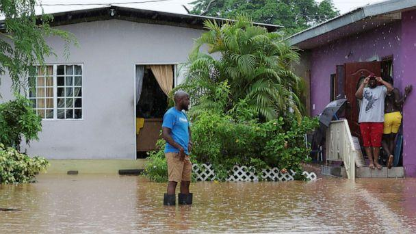 PHOTO: A resident wades through an area flooded by a rain storm caused by Tropical Storm Karen in Barataria, Trinidad and Tobago, Sept. 22, 2019. (Andrea De Silva/Reuters)