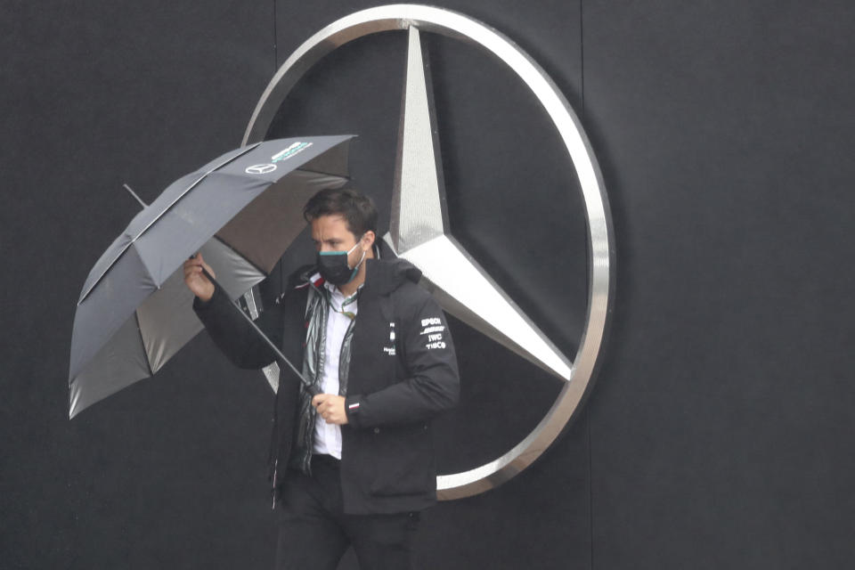 Mercedes team principal Toto Wolff holds the umbrella ahead of the second practice session for the Eifel Formula One Grand Prix at the Nuerburgring racetrack in Nuerburg, Germany, Friday, Oct. 9, 2020. The Germany F1 Grand Prix will be held on Sunday. (AP Photo/Matthias Schrader, Pool)