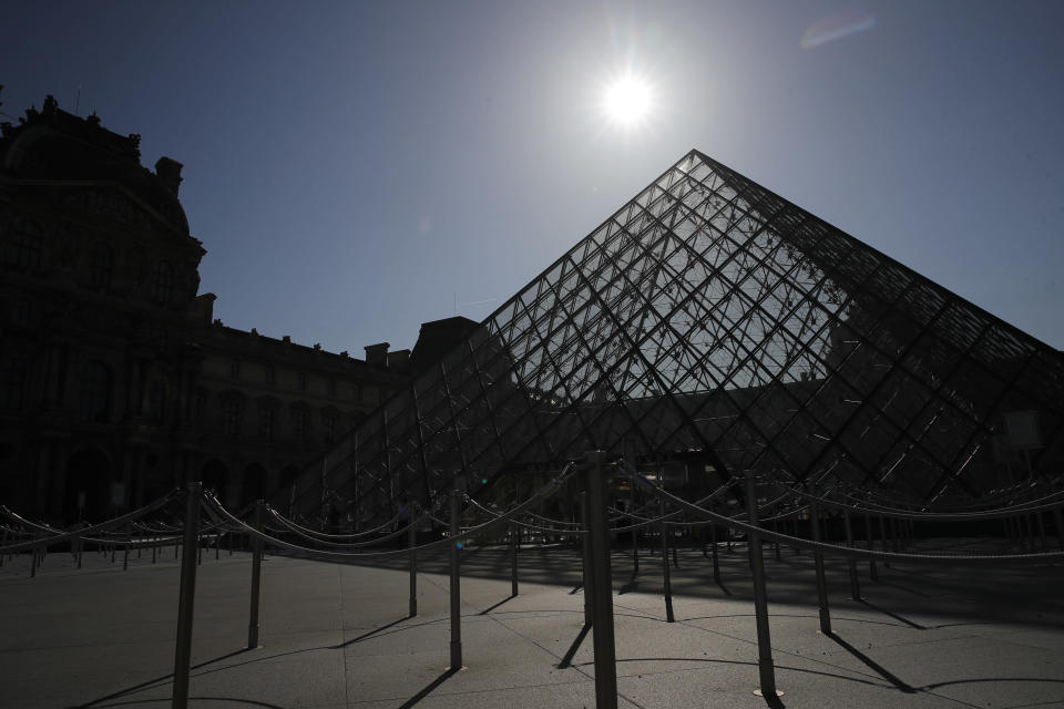FILE - In this Tuesday, June 23, 2020 file photo, the pyramid of the Louvre museum is pictured before a visit ahead of its reopening next July 6, in Paris. The European Union announced Tuesday, June 30, 2020 that it will reopen its borders to travelers from 14 countries, but most Americans have been refused entry for at least another two weeks due to soaring coronavirus infections in the U.S. (AP Photo/Christophe Ena, File)