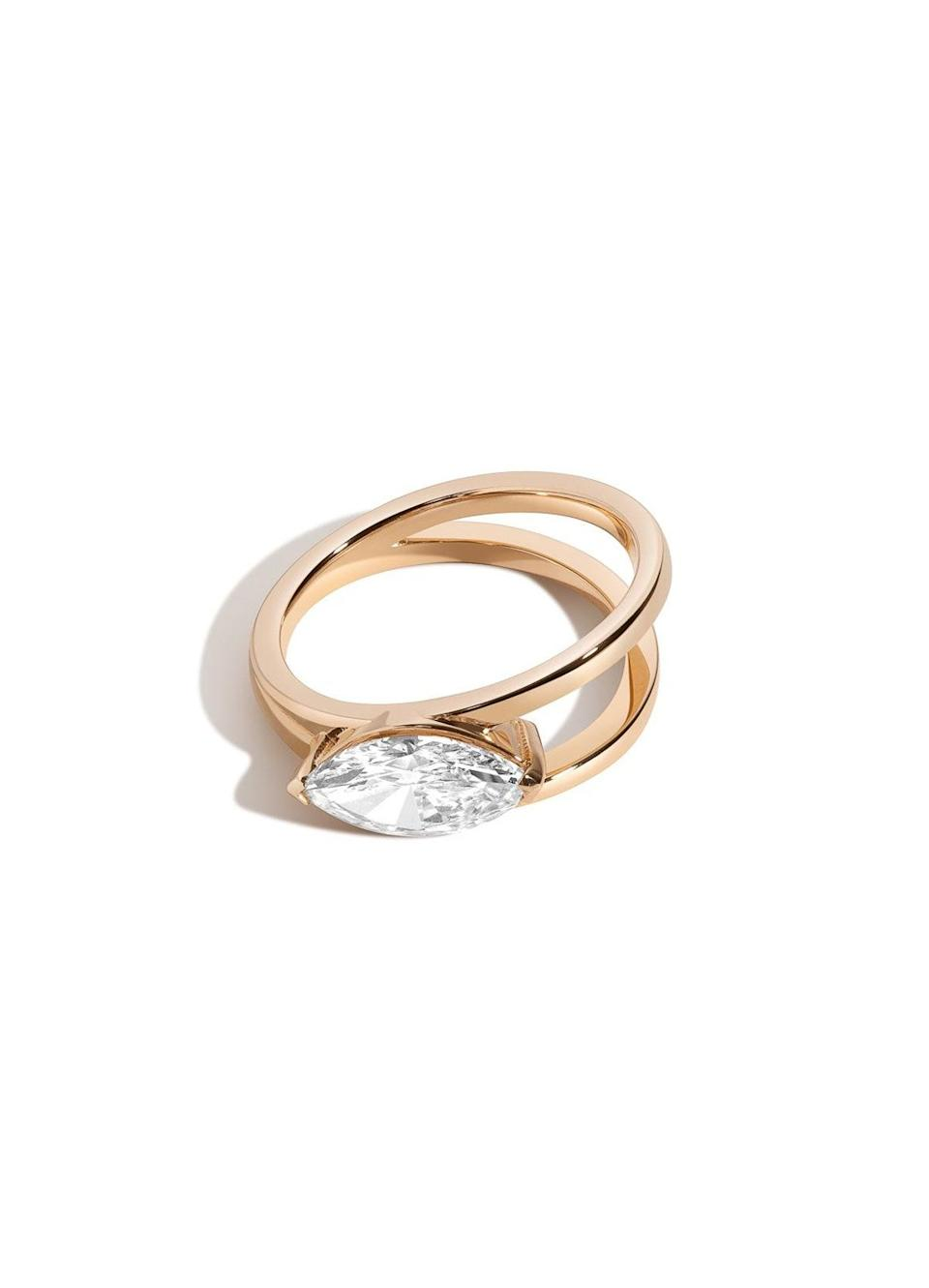 """Oblong cuts (like ovals and pears) have seen a resurgence in the past few years, and right now customers are gravitating to a marquise-cut, which is pointed at both ends. $890, Shahla Karimi. <a href=""""https://shahlakarimi.com/collections/rings/products/marquise-v-ring"""" rel=""""nofollow noopener"""" target=""""_blank"""" data-ylk=""""slk:Get it now!"""" class=""""link rapid-noclick-resp"""">Get it now!</a>"""