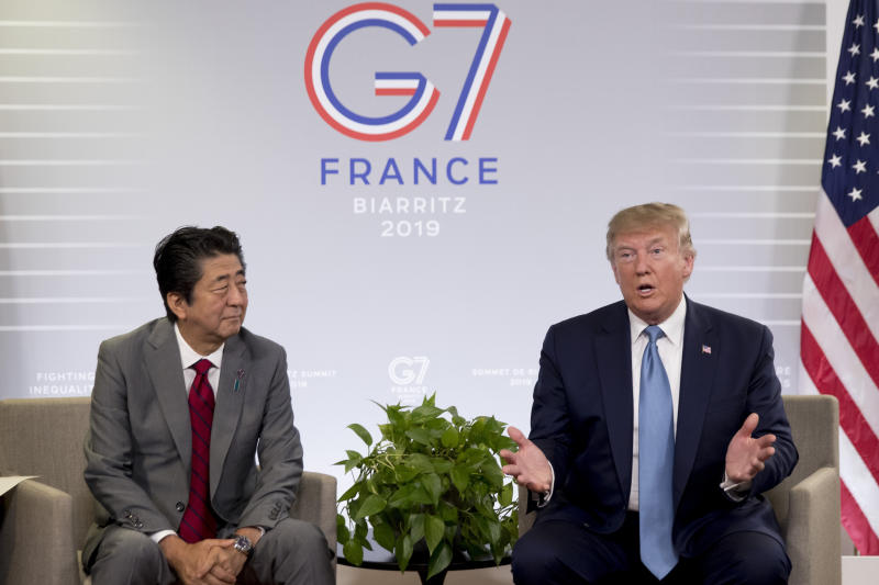 FILE - In this Aug. 25, 2019, file photo, U.S President Donald Trump and Japanese Prime Minister Shinzo Abe speak during a bilateral meeting at the G-7 summit in Biarritz, France to announce that the U.S. and Japan have agreed in principle on a new trade agreement. On Tuesday, Sept. 17, 2019, officials in Japan appear wary over the prospects for a trade deal with the U.S. after President Donald Trump said he was prepared to sign a pact soon. (AP Photo/Andrew Harnik, File)