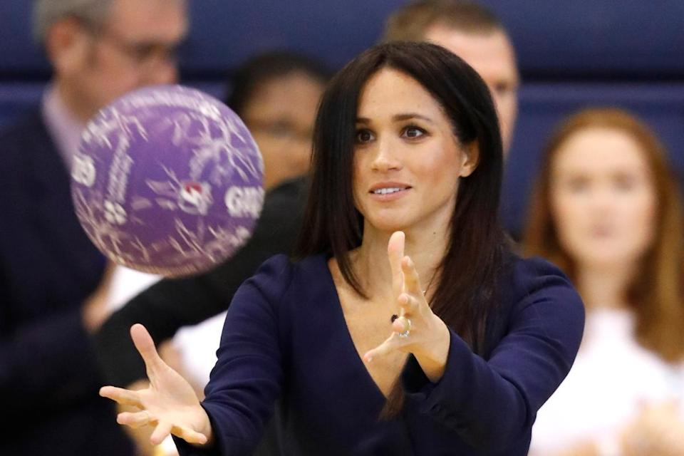 The Duchess of Sussex takes part in a netball workshop (Getty)