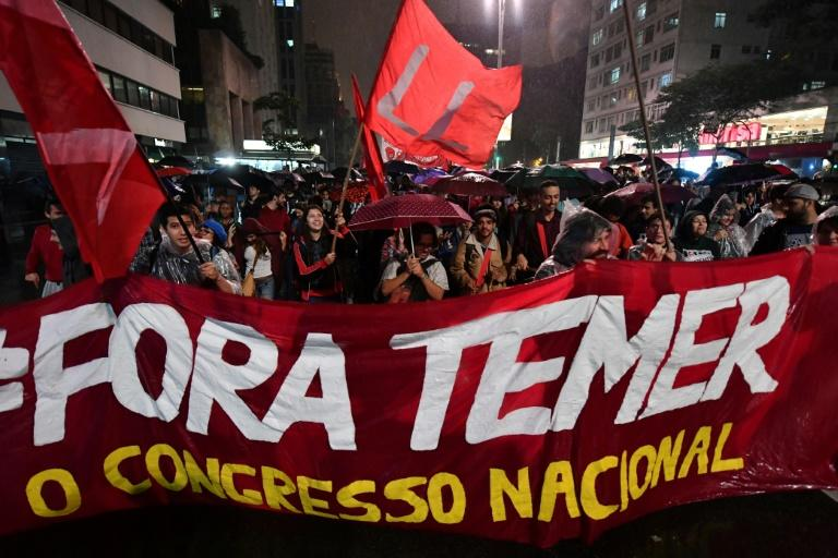 Demonstrators protest against Brazilian President Michel Temer along Paulista Avenue in Sao Paulo, Brazil on May 18 2017