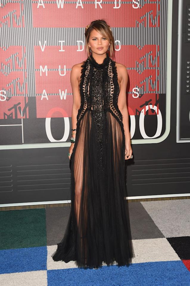 <p>Chrissy Teigen stole the show at the MTV Music Awards by wearing this Marchesa dress that boasts not one, but two thigh-high slits. Her modesty being kept under-wraps by some sheer fabric. [Photo: Getty] </p>
