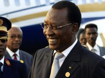Chad president Idriss Deby smiles after arriving at Khartoum Airport on an official visit