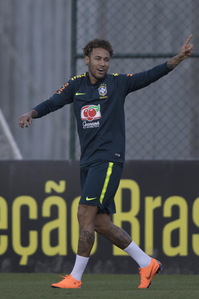 Brazil's Neymar gestures during a practice session of the Brazil national soccer team at the Granja Comary training center, in Teresopolis, Brazil, Tuesday, May 22, 2018. (AP Photo/Leo Correa)