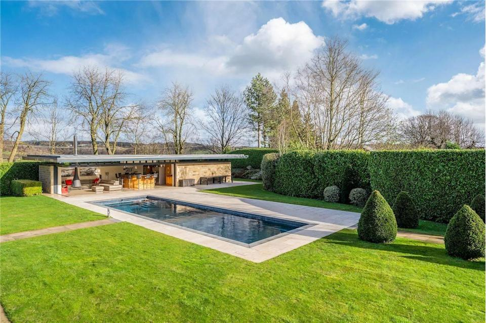 <p>There's also an outdoor heated pool and extensive pool house — the perfect party hangout spot. </p>