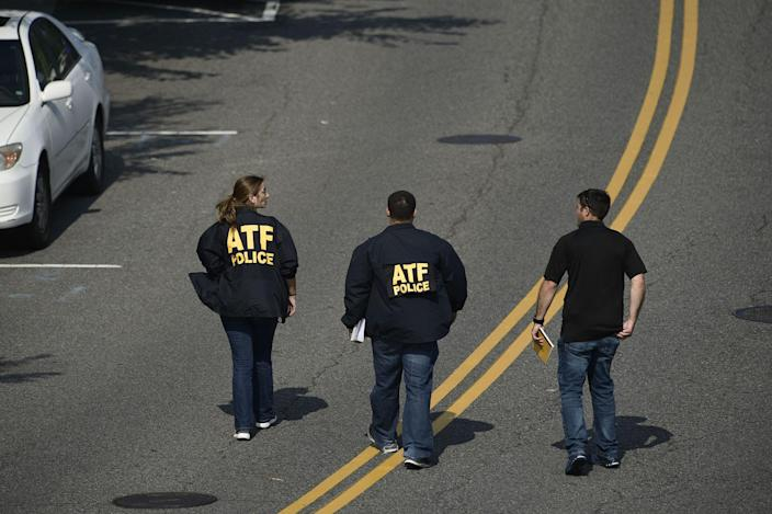 <p>Bureau of Alcohol, Tobacco, Firearms and Explosive (ATF) police members walk near the crime scene of an early morning shooting in Alexandria, Virginia, June 14, 2017. (Photo: Brendan Smialowski/AFP/Getty Images) </p>