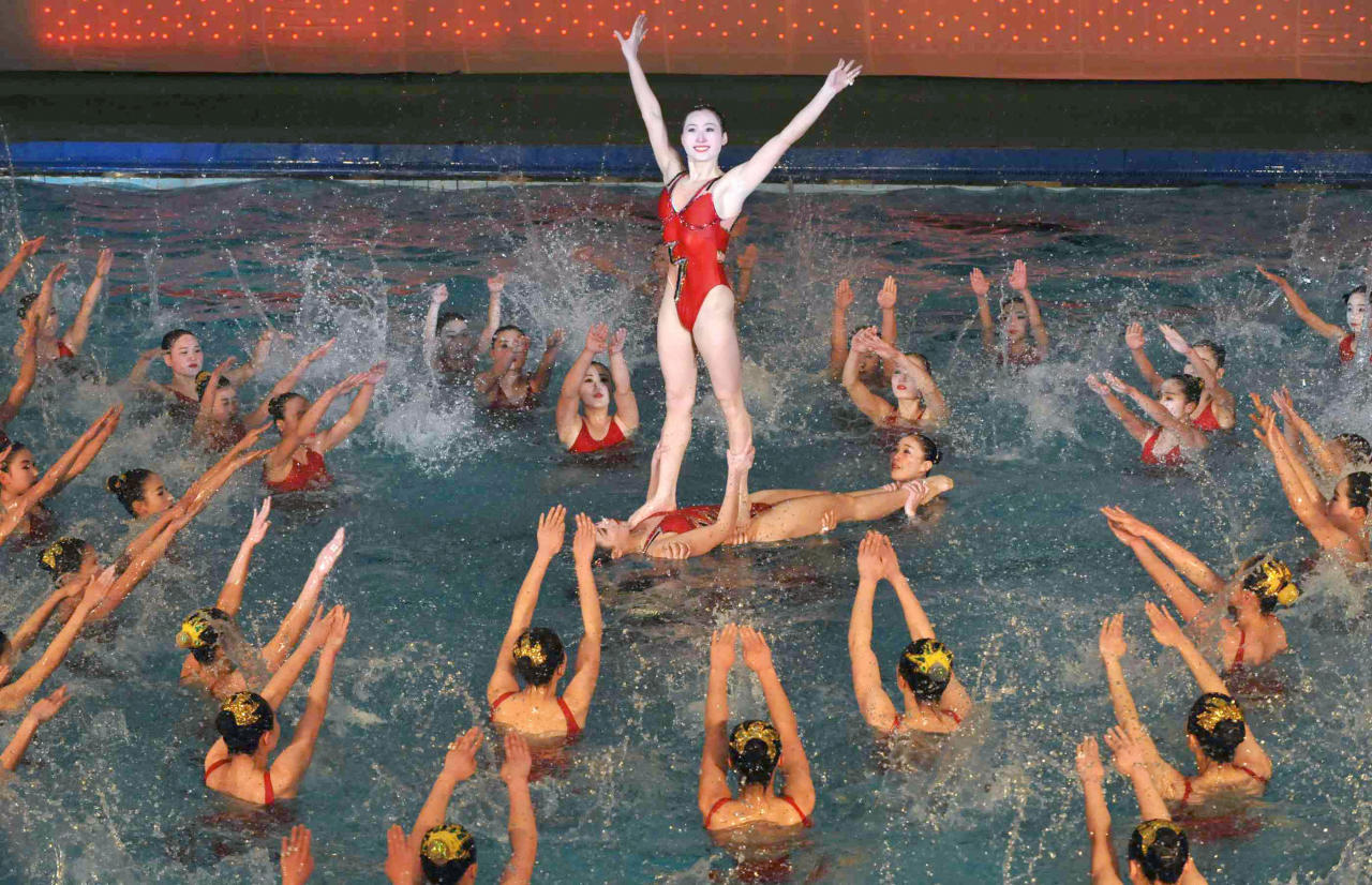 "North Koreans perform a synchronized swimming program titled ""We protect North Korea's new leader Kim Jong-un at the risk of our own life"" during a festival to mark the birth anniversary of the North's late leader Kim Jong-Il in Pyongyang in this photo taken by Kyodo February 15, 2012. Kim's 70th birthday falls on February 16, 2012. Mandatory Credit 