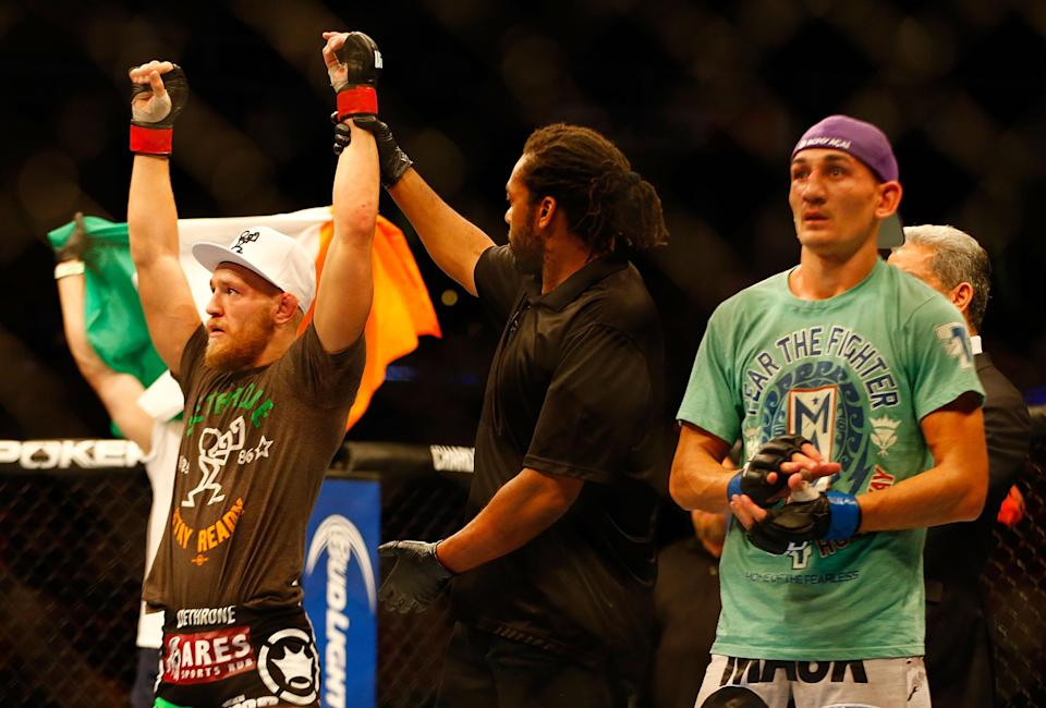Max Holloway (R) has won nine straight fights since losing to Conor McGregor in 2013. (Getty)