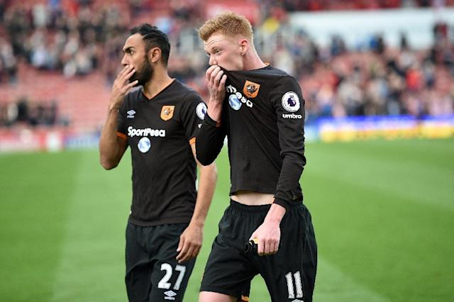 Hull City's Ahmed Elmohamady (L) and Sam Clucas react to their defeat on the pitch after their match against Stoke at the Bet365 Stadium in Stoke-on-Trent, central England on April 15, 2017 (AFP Photo/Oli SCARFF )