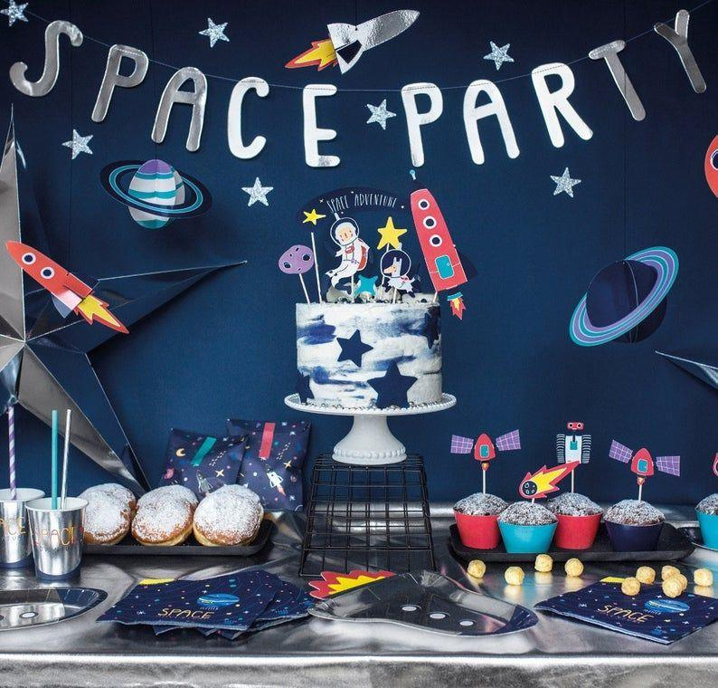 """<p><strong>PartyTouchesUK</strong></p><p>etsy.com</p><p><a href=""""https://go.redirectingat.com?id=74968X1596630&url=https%3A%2F%2Fwww.etsy.com%2Flisting%2F922426564%2Fouter-space-party-decorations-space&sref=https%3A%2F%2Fwww.womansday.com%2Flife%2Fg32946619%2Fboy-birthday-party-ideas%2F"""" rel=""""nofollow noopener"""" target=""""_blank"""" data-ylk=""""slk:Shop Now"""" class=""""link rapid-noclick-resp"""">Shop Now</a></p><p>A space party theme works well for both littles and bigs, whether they dream of one day becoming an astronaut or are more into <em>Star Wars</em>. Set the tone with outer space-themed tablecloths, glow-in-the-dark party props, and rocket ship balloon garlands that will transport you to a galaxy far, far away.</p>"""