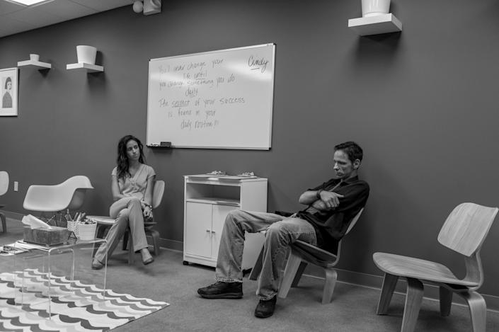 <p>Jack Barrett, a recovering heroin addict, sits in the group therapy room under the watchful eye of counselor Ana Cristina Weickert at Groups in Middletown, Ohio.<br> (Photograph by Mary F. Calvert for Yahoo News) </p>