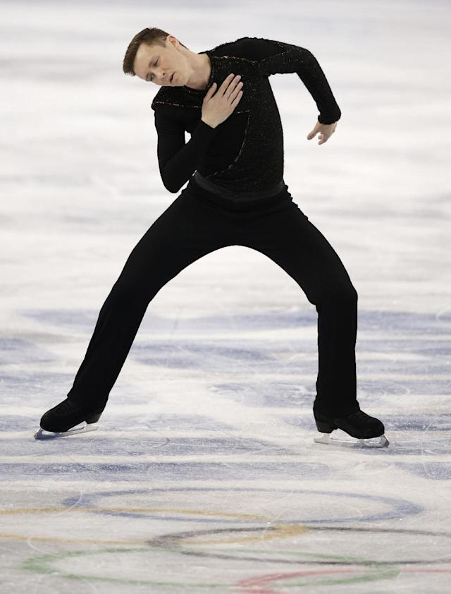 Jeremy Abbott of the United States competes in the men's free skate figure skating final at the Iceberg Skating Palace during the 2014 Winter Olympics, Friday, Feb. 14, 2014, in Sochi, Russia. (AP Photo/Darron Cummings)