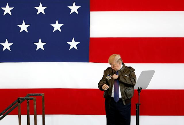 President Donald Trump points to a detail on his flight jacket while on stage at a U.S. Air Force base on the outskirts of Tokyo, Japan, onNov. 5, 2017.