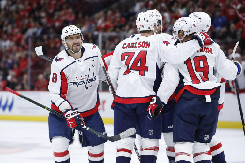 Washington Capitals defenseman John Carlson (74) celebrates with teammates after scoring against the Chicago Blackhawks during the first period of a preseason NHL hockey game Wednesday, Sept. 25, 2019, in Chicago. (AP Photo/Kamil Krzaczynski)