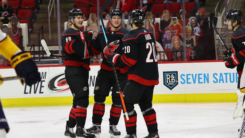 RALEIGH, NC - MARCH 11: Carolina Hurricanes celebrate a goal during the 3rd period of the Carolina Hurricanes vs Nashville Predators on March 11th, 2021 at PNC Arena in Raleigh, NC. (Photo by Jaylynn Nash/Icon Sportswire via Getty Images)