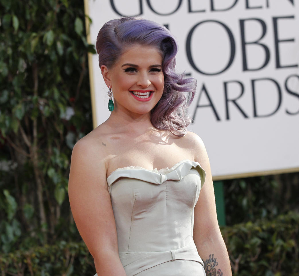 Television personality Kelly Osbourne arrives at the 70th annual Golden Globe Awards in Beverly Hills, California, January 13, 2013.  REUTERS/Mario Anzuoni (UNITED STATES  - Tags: ENTERTAINMENT)  (GOLDENGLOBES-ARRIVALS)