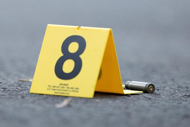 An evidence marker sits next to a rifle casing at the scene of a fatal shooting in the 4500 block of South Hermitage Avenue on Sept. 5, 2016, in the Back of the Yards neighborhood of Chicago. (Photo: Erin Hooley/Chicago Tribune/TNS via Getty Images)