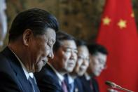 """Chinese President Xi Jinping, left, sits in front of the Italian Premier Giuseppe Conte ahead of the signing ceremony of a memorandum of understanding at Rome's Villa Madama, Saturday, March 23, 2019. Italy signed a memorandum of understanding with China on Saturday in support of Beijing's """"Belt and Road"""" initiative, which aims to weave a network of ports, bridges and power plants linking China with Africa, Europe and beyond. (Giuseppe Lami/ANSA Via AP)"""
