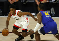 Toronto Raptors' Stanley Johnson (5) drives against Denver Nuggets' Noah Vonleh (32) during the fourth quarter of an NBA basketball game Friday, Aug. 14, 2020, in Lake Buena Vista, Fla. (Mike Ehrmann/Pool Photo via AP)