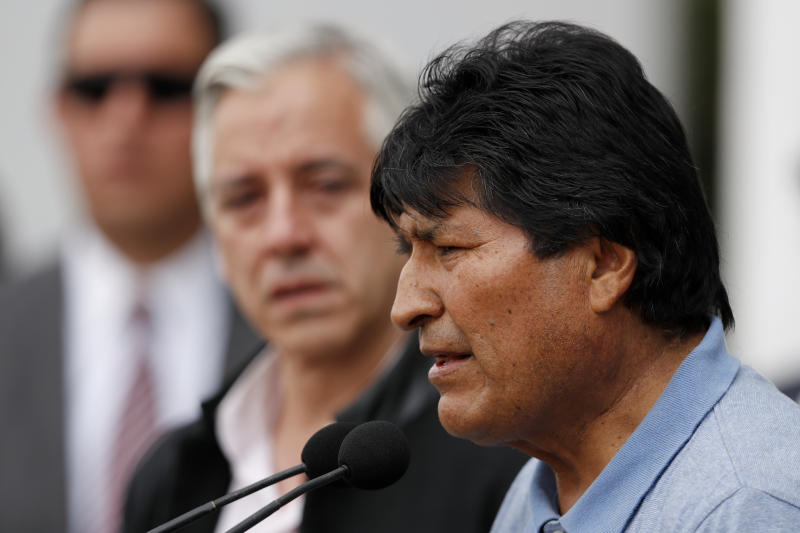 Former Bolivian President Evo Morales speaks upon his arrival in Mexico City, Tuesday, Nov. 12, 2019. Mexico granted asylum to Morales, who resigned on Nov. 10 under mounting pressure from the military and the public after his re-election victory triggered weeks of fraud allegations and deadly protests. (AP Photo/Eduardo Verdugo)