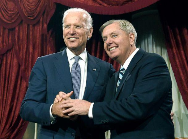 PHOTO: Vice President Joe Biden shares a laugh with Sen. Lindsey Graham, R-S.C. before Biden administered the Senate oath during a ceremonial re-enactment swearing-in ceremony, Jan. 6, 2015, on Capitol Hill. (Susan Walsh/AP)