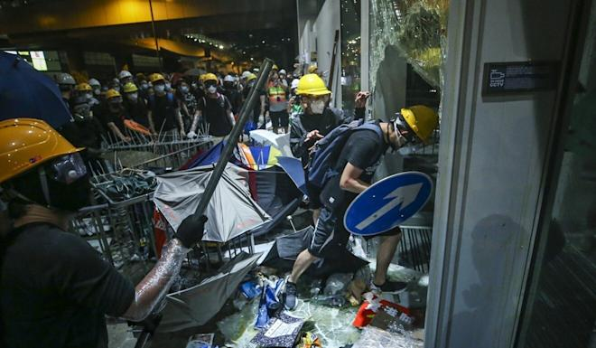 Radical protesters storm the Legco complex on July 1 last year on the 22nd anniversary of Hong Kong's handover to mainland China. Photo Winson Wong