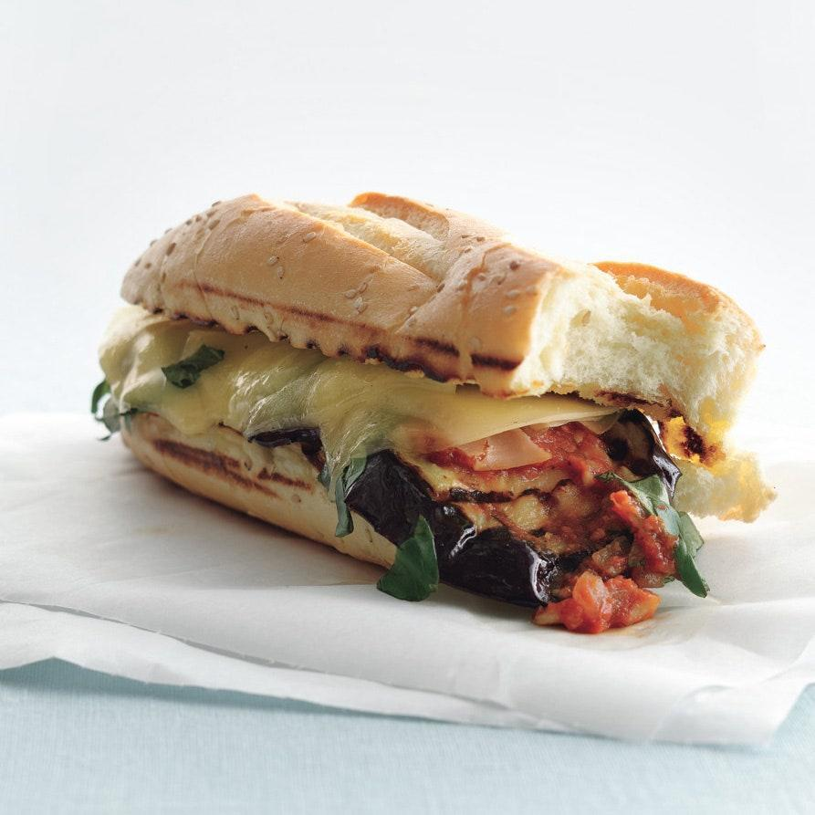 """Eggplant could be the mascot for grilled vegetables. When charred on high heat, eggplant takes on a characteristic that matches provolone point to smoky point. <a href=""""https://www.epicurious.com/recipes/food/views/grilled-eggplant-parmigiana-heros-354972?mbid=synd_yahoo_rss"""" rel=""""nofollow noopener"""" target=""""_blank"""" data-ylk=""""slk:See recipe."""" class=""""link rapid-noclick-resp"""">See recipe.</a>"""