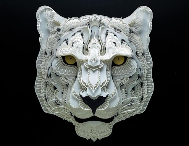 <p>Intricate paper cut out of a snow leopard. (Photo: Patrick Cabral/Caters News </p>