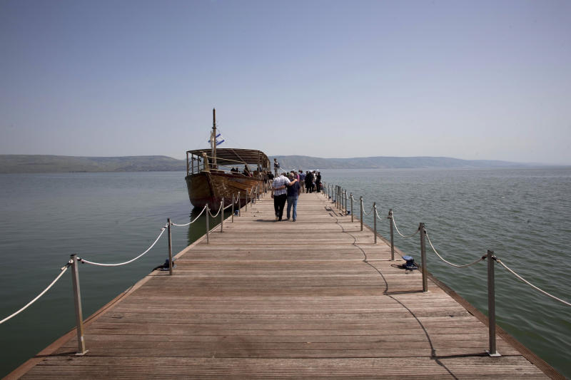 File - In this April 14, 2011 file photo, a boat is by the jetty of the Capernaum National Park in the Sea of Galilee in northern Israel.  The monumental structure, made of boulders and stones with a diameter of 70 meters, was found through a sonar scan at the bottom of the Sea of Galilee in 2003. Now, archaeologists are beginning to put together grant proposals and funding requests in a bid to permit them access to the submerged stones.(AP Photo/Bernat Armangue, File)