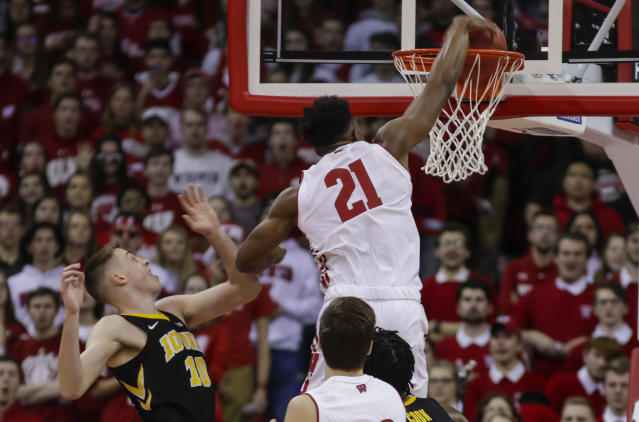 Wisconsin's Khalil Iverson (21) dunks past Iowa's Joe Wieskamp (10) during the first half of an NCAA college basketball game Thursday, March 7, 2019, in Madison, Wis. (AP Photo/Andy Manis)