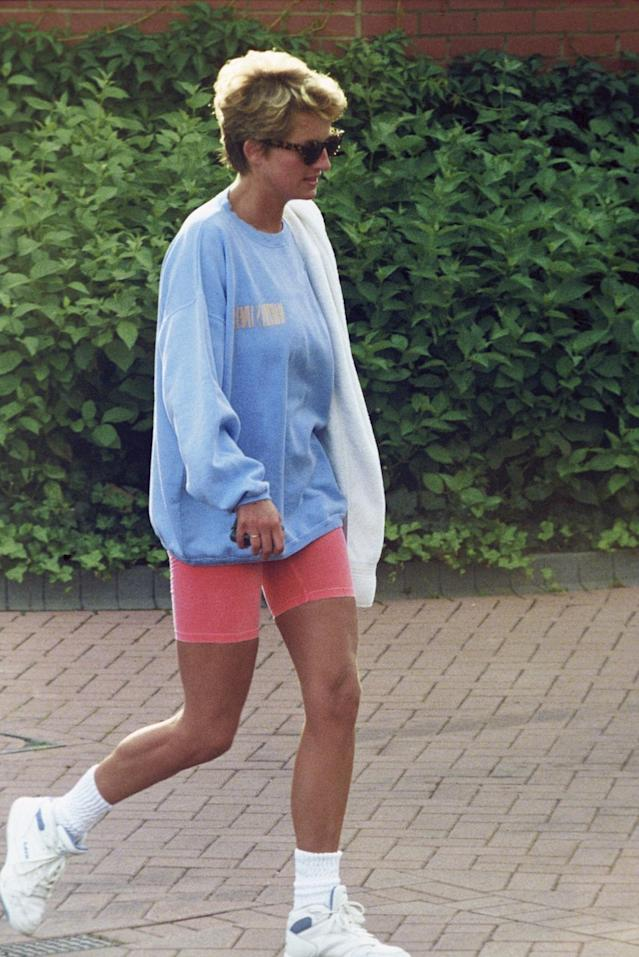 <p>The Princess of Wales was notoriously fit, and that obviously comes from hard work at the gym. She was never shy — particularly after her separation — about wearing sweatshirts and shorts in public after a workout. (Photo: Anwar Hussein/Getty Images) </p>