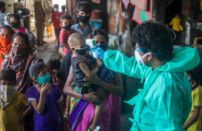 MUMBAI, INDIA MAY 29: Team of Doctors check the temperature and pulse rate of a local residents at a COVID-19 coronavirus testing drive inside the Dharavi slums during a government-imposed nationwide lockdown as a preventive measure against the spread of the COVID-19 coronavirus, on May 29, 2020 in Mumbai, India. (Photo by Pratik Chorge/Hindustan Times via Getty Images)