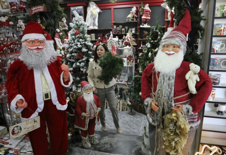 A Palestinian shop displays Christmas gifts in the city of Bethlehem in the occupied West Bank (AFP Photo/HAZEM BADER)