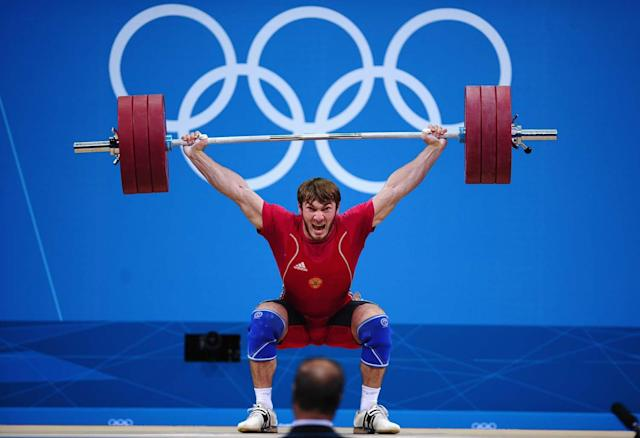 LONDON, ENGLAND - AUGUST 03: Apti Aukhadov of Russia competes during the Men's 85kg Weightlifting Final on Day 7 of the London 2012 Olympic Games at ExCeL on August 3, 2012 in London, England. (Photo by Laurence Griffiths/Getty Images)