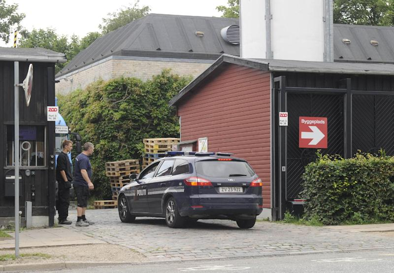 Police secure an entrance at Copenhagen Zoo in Copenhagen, Denmark, Wednesday July 11, 2012, after the body of a man was found by a zoo keeper earlier Wednesday. Police say a 21-year old foreign national man who holds a Danish residence permit, was found dead inside the tiger den at the Copenhagen Zoo with his throat bitten. The man's name and nationality were not immediately released. (AP Photo/Kenneth Meyer, POLFOTO) DENMARK OUT