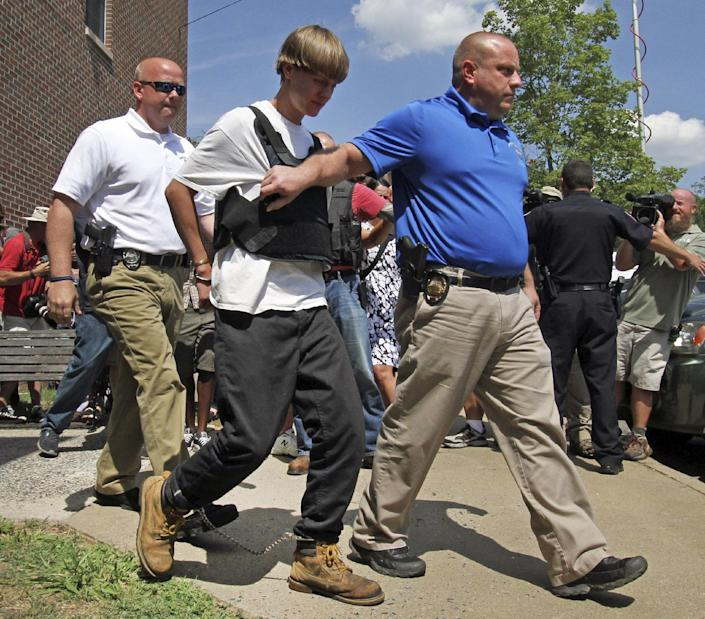 Dylann Roof is escorted to court last Thursday by Shelby, N.C. police detectives. (AP/Ben Earp)