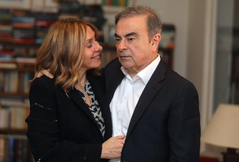 Former Nissan chairman Carlos Ghosn and his wife Carole Ghosn pose for a picture after an exclusive interview with Reuters in Beirut