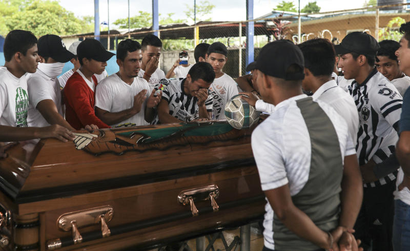 Alexander Martinez's family and friends mourn during his funeral in Acatlan de Perez Figueroa, Mexico, Thursday, June 11, 2020. Hundreds of residents of this town in southern Mexico bid farewell amid anger and tears to Alexander Martinez, a 16-year-old Mexican-American boy shot dead by local police. (AP Photo/Felix Marquez)