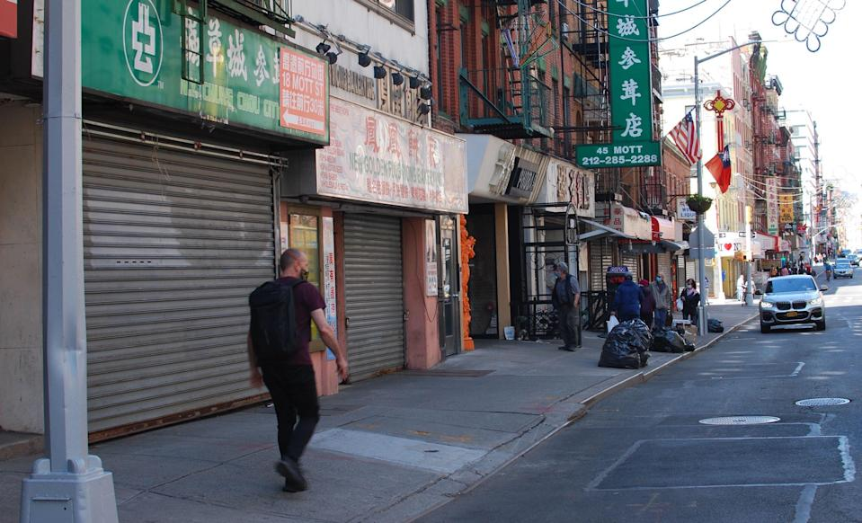 A man walks through a quiet Mott Street on May 17. Businesses in Chinatown saw revenues fall well before the first cases in the U.S., as headlines out of China sparked concern from both tourists and Chinatown employees. Photo: Brian Cheung / Yahoo Finance