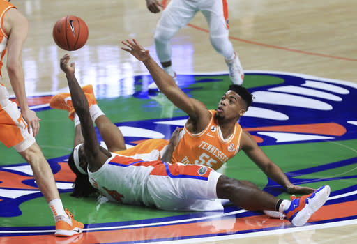 Florida forward Anthony Duruji (4) and Tennessee forward E.J. Anosike (55) vie for the ball at midcourt during the first half of an NCAA college basketball game Tuesday, Jan. 19. 2021, in Gainesville, Fla. (AP Photo/Matt Stamey)