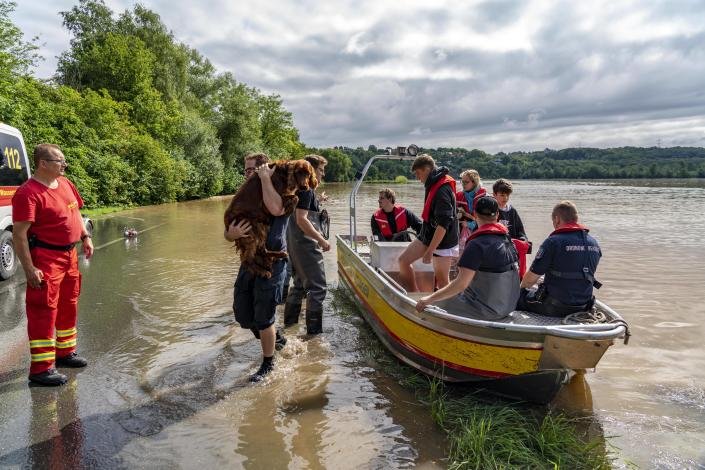 Residents are rescued from flooded houses by firefighters in the district of Dahlhausen in Bochum, Nordrhein-Westphalia, Germany.