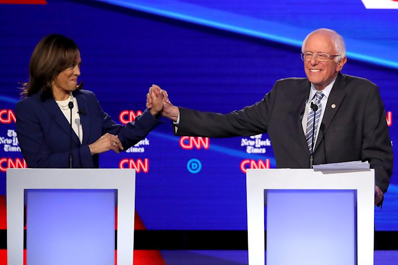 Senator Kamala Harris and Senator Bernie Sanders onstage during the Democratic Presidential Debate on October 15, 2019 in Westerville, Ohio.