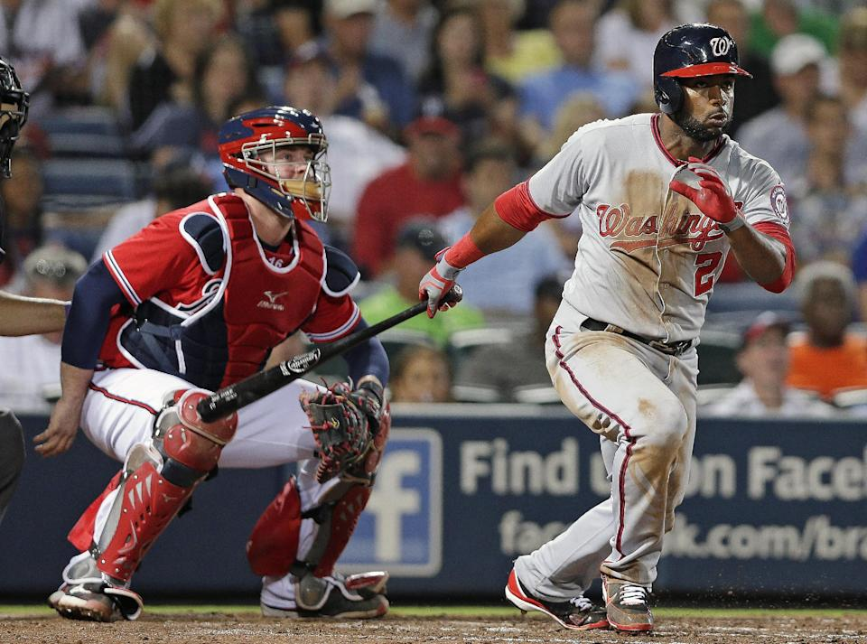 Washington Nationals' Denard Span (2) follows through with a triple as Atlanta Braves catcher Brian McCann looks on in the sixth inning of a baseball game in Atlanta, Friday, May 31, 2013. It was Span's second triple of the game. (AP Photo/John Bazemore)