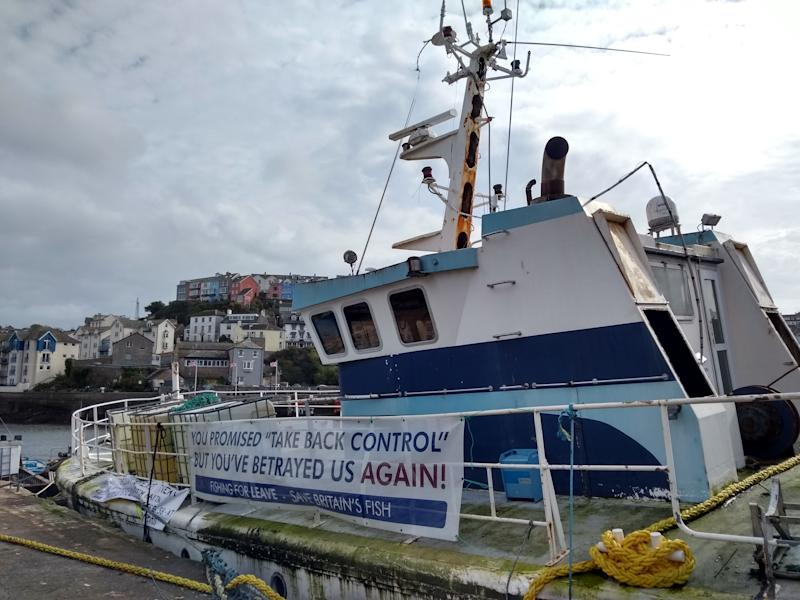 A picture shows a 'Fishing For Leave' campaign group sign about Brexit on a boat in the harbour in Brixham, southern England, on October 11, 2018. - Tensions are already high between the French and British fishing fleets due to the scallop wars but Brexit could change the game completely by redrawing the battle lines in the Channel. French fishermen are anxious to avoid a hard Brexit that could shut them out of British territorial waters, while in UK ports, trawlermen hope such moves could reinvigorate the British fishing industry. (Photo by Robin MILLARD / AFP) (Photo credit should read ROBIN MILLARD/AFP/Getty Images)